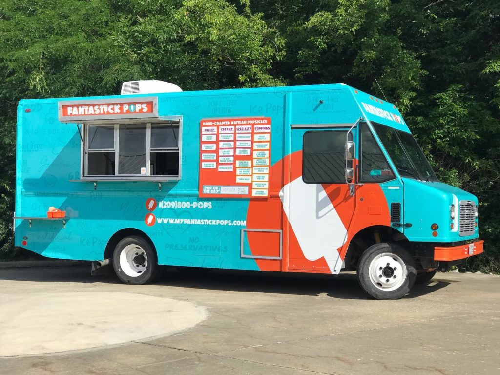 large teal and orange popsicle food truck