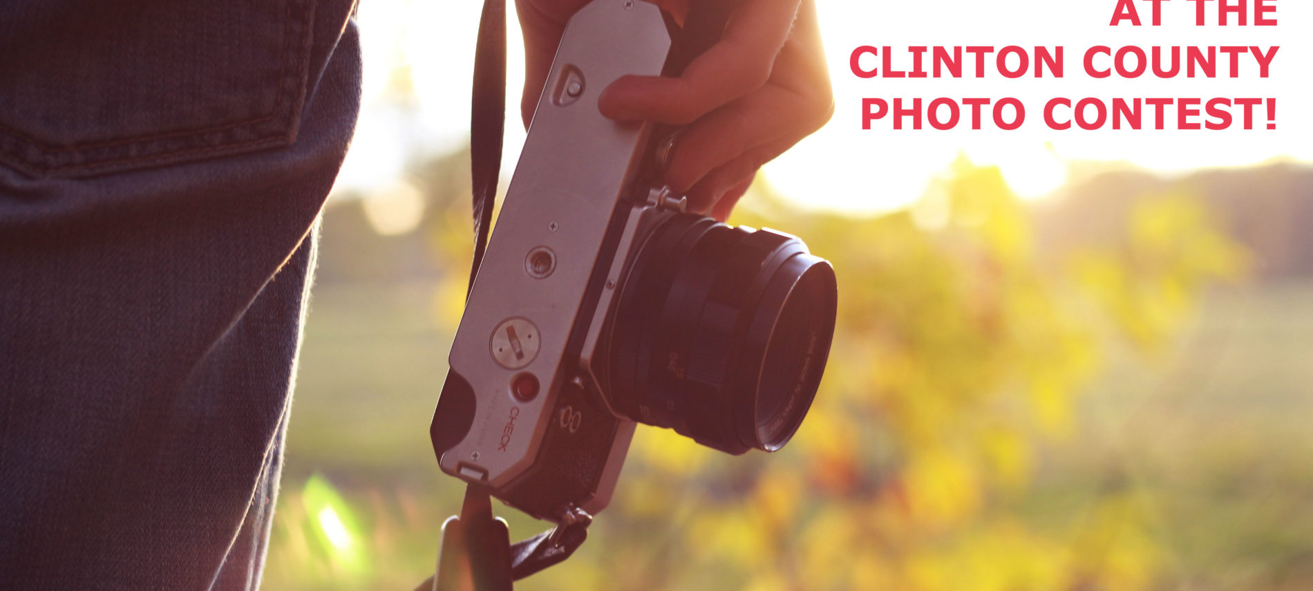 Close up photo of a camera with the title: Clinton County Photo Contest.