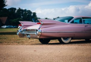 Back view of a classic Cadillac  with fins