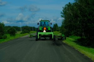 John Deere tractor on a country road