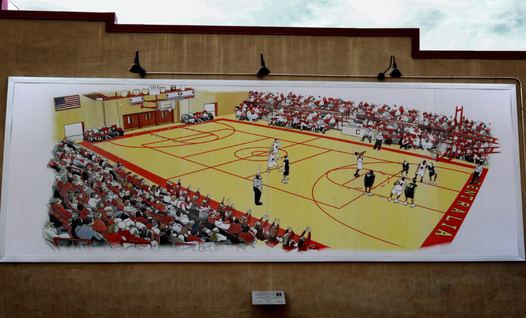 Last game shows the high school gym during a game.