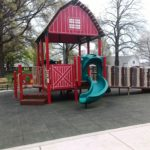a photo of the cute, covered playhouse at Hannah's Playground