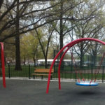 Photo of the red swing set at the playground.
