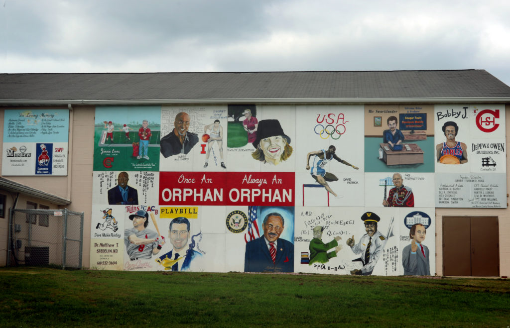 Youth mural depicting a collage of local personalities.