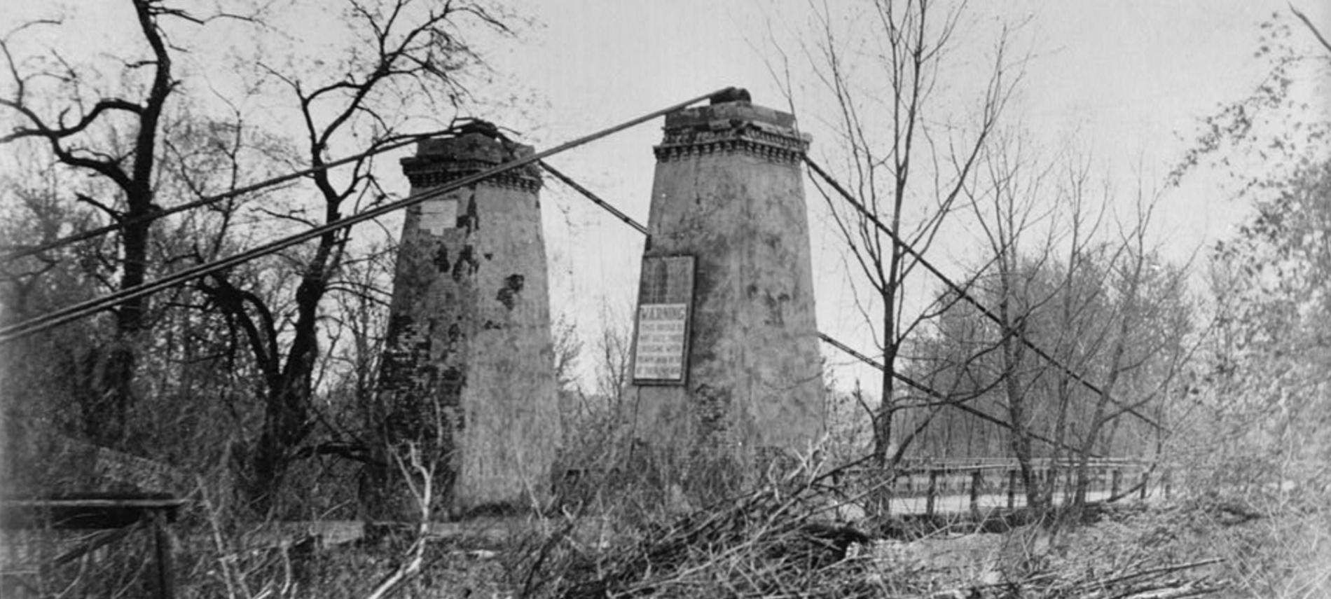 Black and white photo of historic suspension bridge in Carlyle IL