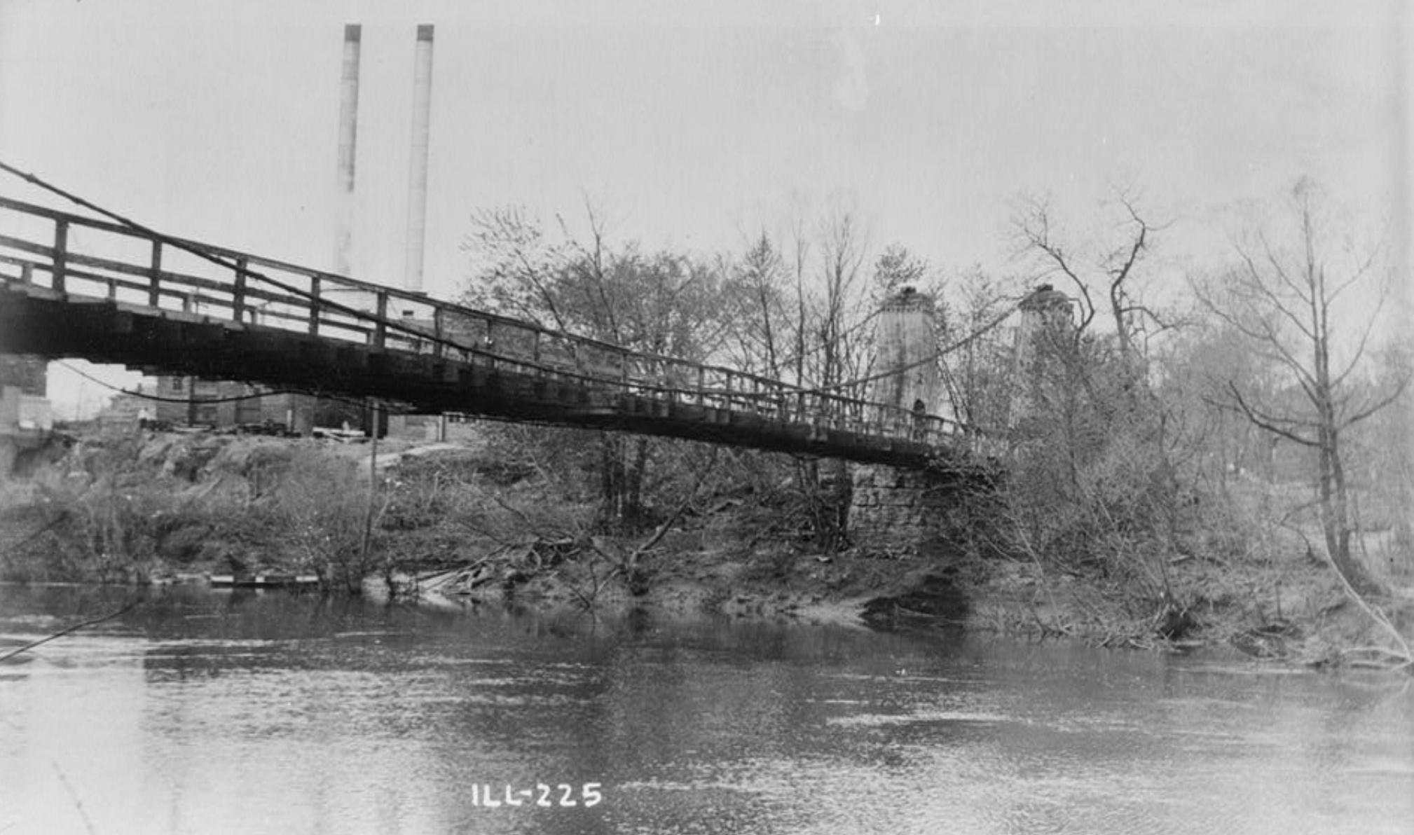 Black and white photo of historic suspension bridge in Carlyle Illinois