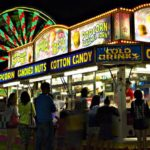 Photo of the concession stand at the Clinton County Fair, all lit up at nighttime.