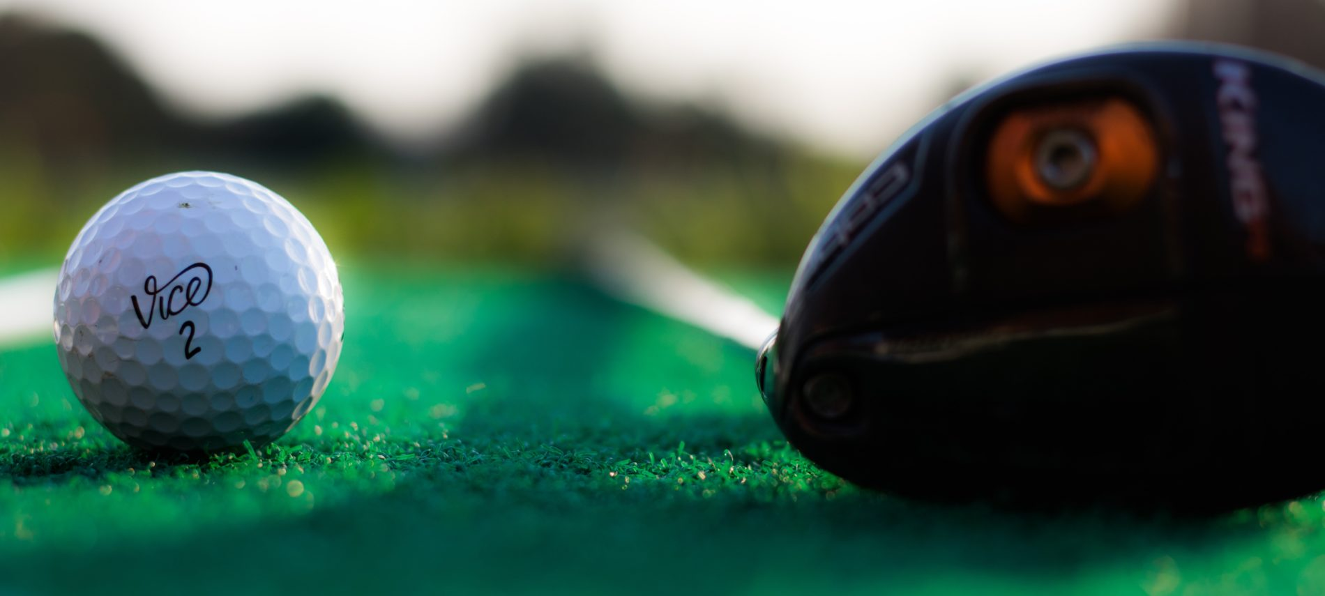 Close up view of a ball and driver.