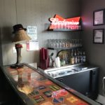 The small bar area, showing the bar top and one wall with a Budweiser sign.