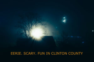 a spooky nighttime scene with a full moon and ominous looking shadows.